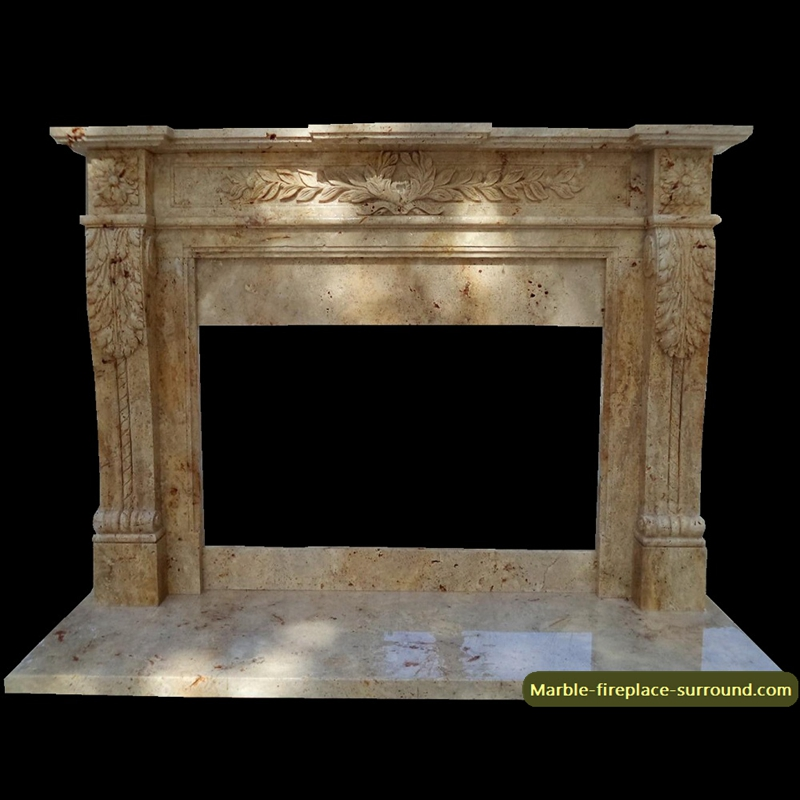 travertine fireplace with wreath relief